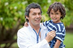 Family doctor outdoors Stock Images
