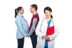 Family doctor and pregnant couple stock photography
