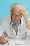 Family doctor prescribing medication Stock Photos