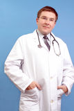 Family doctor with stethoscope Stock Image