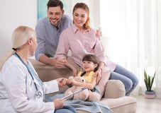 Family doctor visiting ill child stock photos