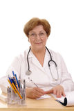 Family doctor writing prescription Stock Images