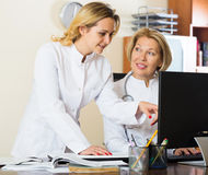 Family doctors therapeutists discussing difficult case in office Stock Photos