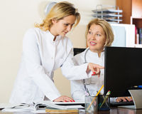 Family doctors therapeutists discussing difficult case in office Royalty Free Stock Photography