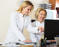 Family doctors therapeutists discussing difficult case in office Royalty Free Stock Images