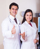 Family doctors therapeutists with stethoscope posing in private Royalty Free Stock Photo