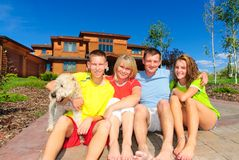 Family and dog. Complete family with dog by their home Royalty Free Stock Photography