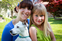 Family Dog. Portrait of mom and daughter with the family dog Royalty Free Stock Photo