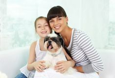 Family with dog Stock Image