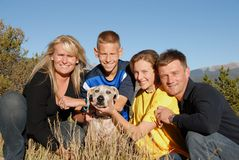 Family with  dog. Family in the mountains with their dog Stock Image