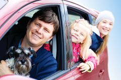 Family with a dog in the car. Smiling family with a dog in the car Royalty Free Stock Photography