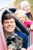 Family with a dog in the car Royalty Free Stock Photos
