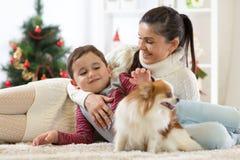 Family with dog at christmas tree Stock Photo