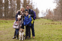 Family and dog in the countryside, full length portrait Stock Image