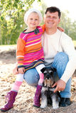 Family with a dog Royalty Free Stock Photos