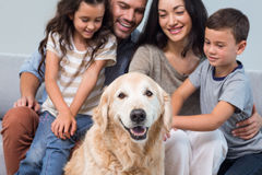 Family with dog in living room Royalty Free Stock Photography