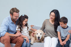 Family with dog in living room Stock Photos