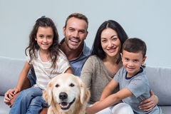 Family with dog in living room Royalty Free Stock Images