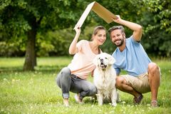 Family with dog and roof. As home or building construction concept Royalty Free Stock Photos