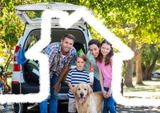 Family and dog standing on the road against home outline in background. Digital composite image of family and dog standing on the road against home outline in royalty free stock photography