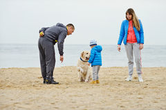 Family  with dog Royalty Free Stock Photos
