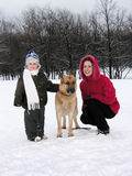 Family with dog. winter. Mother with son royalty free stock photography