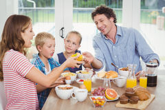 Family doing breakfast in house Royalty Free Stock Photos