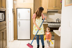 Family doing domestic chores royalty free stock images