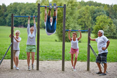 Family doing fitness training in park Royalty Free Stock Photo
