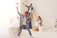 Family doing home renovation Stock Images
