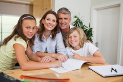Family doing homework Royalty Free Stock Images