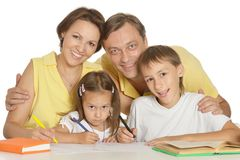 Family doing homework Stock Photos