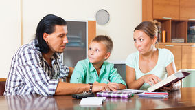 Family doing homework in home Stock Image