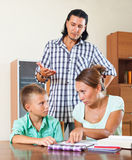Family doing homework Royalty Free Stock Photos
