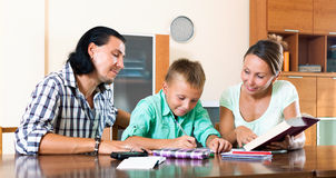Family doing homework Stock Photo