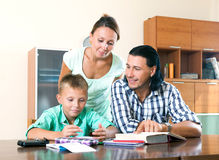 Family doing homework together Royalty Free Stock Photo