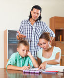 Family doing homework Royalty Free Stock Photography
