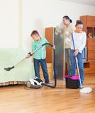 Family doing house cleaning Royalty Free Stock Image