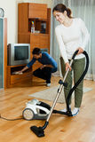 Family doing housework together in home stock photography