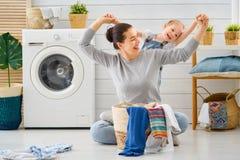 Family doing laundry royalty free stock photos