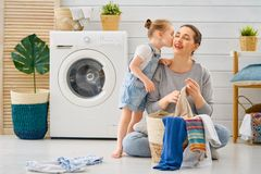 Family doing laundry stock photos