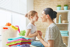 Family doing laundry at home Royalty Free Stock Images