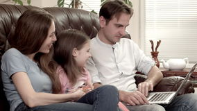 Family doing online shopping with creditcard stock video