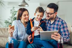 Family doing online shopping with tablet. At home stock photography