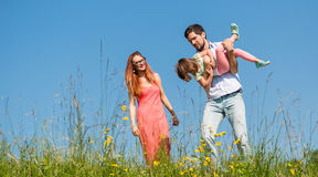 Family doing the plane on summer meadow Royalty Free Stock Image