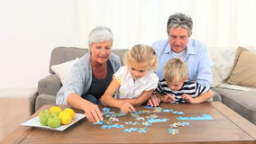 Family doing a puzzle Stock Images