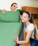 Family doing relocation of furniture Royalty Free Stock Image