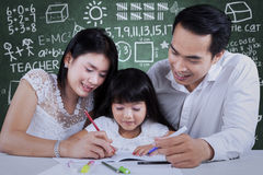 Family doing schoolwork in class Royalty Free Stock Photo