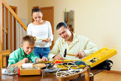 The family is doing something with the working tools Stock Photo