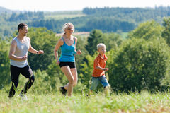 Family doing sports - jogging Royalty Free Stock Photography